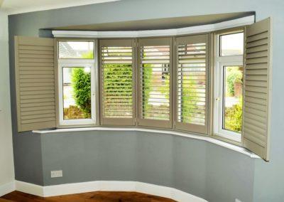 Bay+window+wooden+shutters