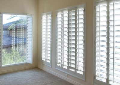 homeguide-white-faux-composition-plantation-shutters-in-bedroom