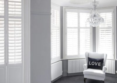 white-wooden-plantation-window-shutters-2000x1200